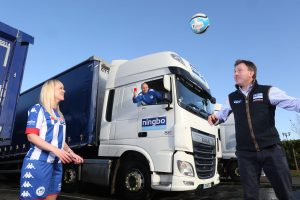 Wigan Athletic Ladies footballer Michelle Hunt thanks Ningbo MD Chris Stockton for the company's sponsorship Also pictured is team coach Derek Booth, Sigma Web